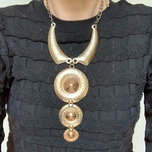 Necklace with an aged bronze look.